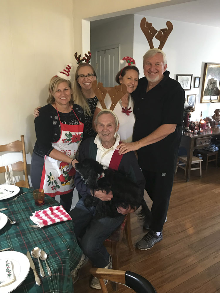 Dr. Paige Davis family on Christmas with reindeer ears