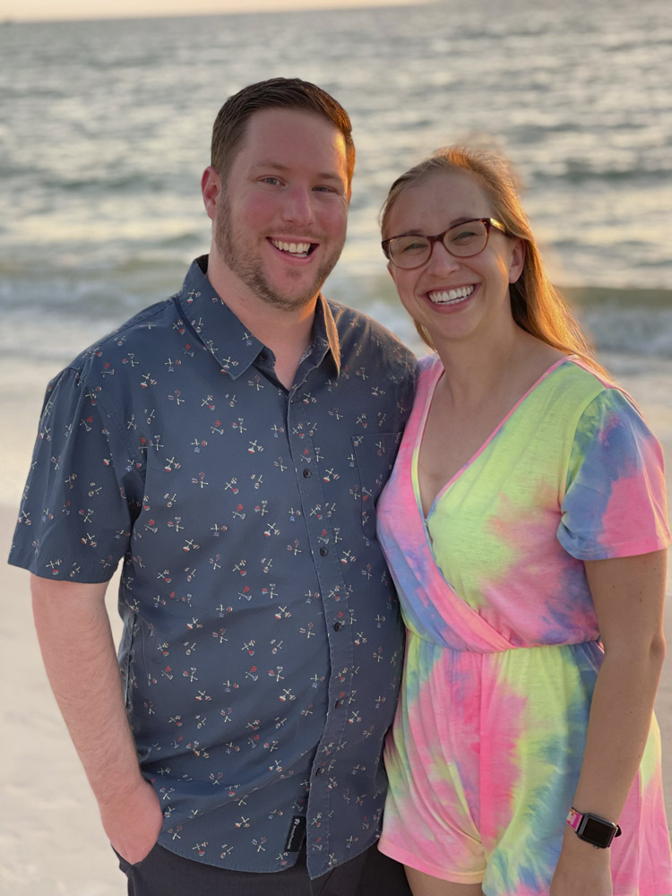 Dr. Paige Davis and fiance standing on beach